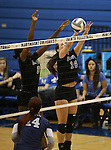 Marymount's Morgan McAlpin and Erin Allison block in a college volleyball game, in Arlington, Vir., on Saturday, Nov. 1, 2014.<br /> Photo by Cathleen Allison