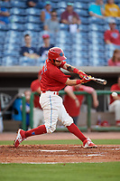 Clearwater Threshers shortstop Jose Gomez (3) puts a ball in play during a game against the Jupiter Hammerheads on April 9, 2018 at Spectrum Field in Clearwater, Florida.  Jupiter defeated Clearwater 9-4.  (Mike Janes/Four Seam Images)