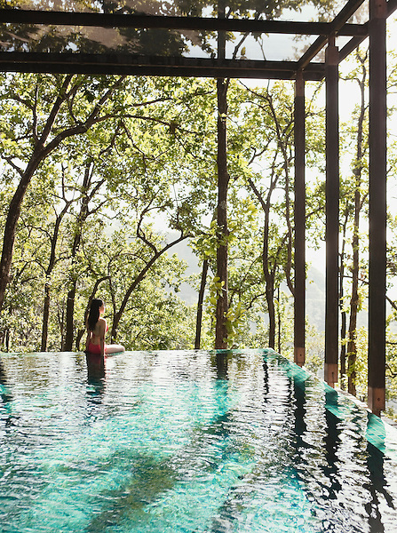 A woman wades in the pool of the Ganga Pool Villa at Ananda in the Himalayas, The Palace Estate, Narendra Nagar, Tehri Garhwal, Uttarakhand, India. The Ganga Pool Villa is a one-bedroom private villa with its own infinity pool.