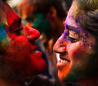 A couple see each other while they attend the Holi Hai festival organized by Indian community in New York City March 31, 2013. Photo by Eduardo Munoz Alvarez / VIEWpress.