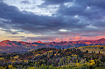 Uncompahgre National Forest, CO: Sunset clouds over Owl Creek Pass and Cimarron Range in fall.