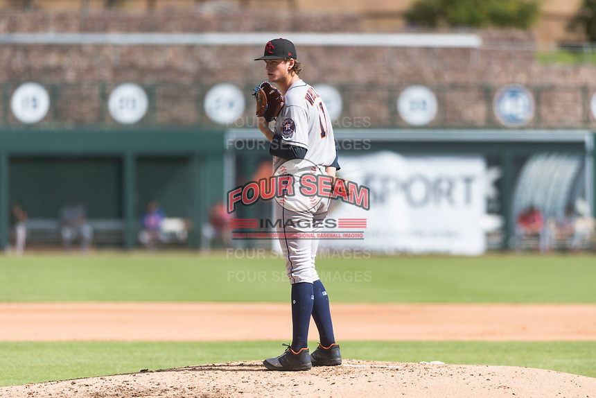 Scottsdale Scorpions starting pitcher Forrest Whitley (11), of the Houston Astros organization, looks in for the sign during an Arizona Fall League game against the Glendale Desert Dogs at Camelback Ranch on October 16, 2018 in Glendale, Arizona. Scottsdale defeated Glendale 6-1. (Zachary Lucy/Four Seam Images)