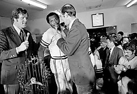 Oakland Athletics dressing room after beating the Cincinnati Reds, Vida Blue is interviewed by Tony Kubak and A's Monte Moore. (1972 photo/Ron Riesterer)
