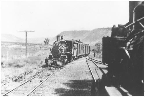 Passenger train moving on to siding at Cedar Creek, CO.<br /> D&amp;RGW  Cedar Creek, CO  ca. 1930