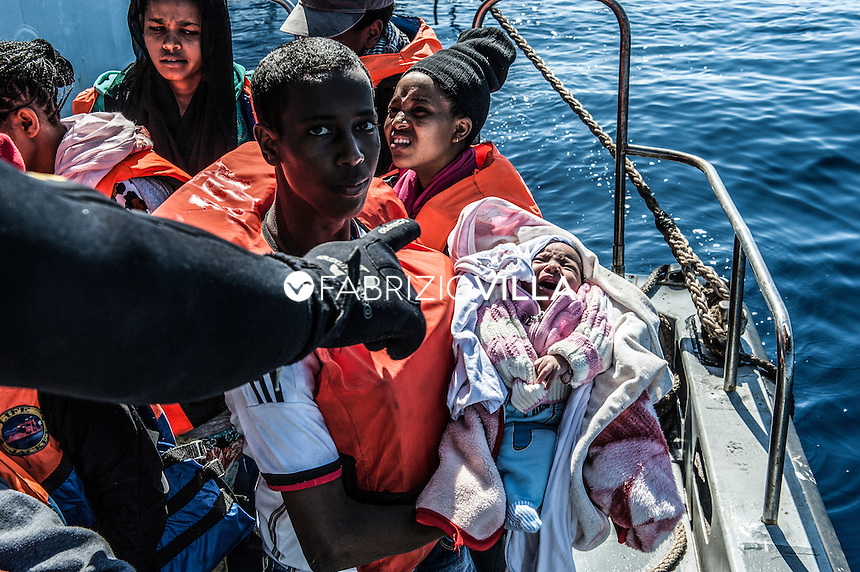 rescue of migrants by ship spica of the italian navy in the mediterranean sea.