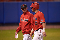 Ball State Cardinals head coach Rich Maloney (2) talks with catcher Jarett Rindfleisch (25) during a game against the Wisconsin-Milwaukee Panthers on February 26, 2016 at Chain of Lakes Stadium in Winter Haven, Florida.  Ball State defeated Wisconsin-Milwaukee 11-5.  (Mike Janes/Four Seam Images)