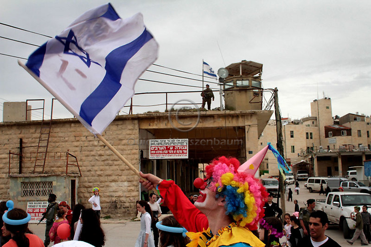 Jewish settlers celebrate Purim in Occupied Hebron area of H2   The feast of Purim commemorates the salvation of the Jews from the ancient Persians as described in the book of Esther, celebrations involve participants dressing up in disguises and enjoying otherwise forbidden revelry. .Photo (C) Quique Kierszenbaum