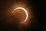 """May 21, 2012, Osaka, Japan - The partial solar eclipse is seen in Yokohama, near Tokyo, Japan on May 21, 2012. An annular solar eclipse was observed over a wide area of Japan on Monday early morning. Millions of people watched as a rare """"ring of fire"""" eclipse crossed the skies. (Photo by Katsuro Okazawa/AFLO) -ty-"""