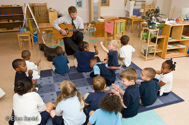 MR / Kensington, Maryland.Crossway Community Montessori School.Private, nonprofit early childhood education for children aged infant through age 6..Many of the students are children of parents from an associated program, Family Leadership School, for single-parent, low income families who live onsite..Primary Class.Students sing as their teacher plays guitar..MR: AH-gPccm.© Ellen B. Senisi