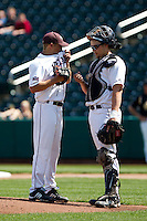 Luke Voit (30) of the Missouri State Bears talks with Pitcher Grant Gordon (35) on the mound during a game against the Wichita State Shockers on April 9, 2011 at Hammons Field in Springfield, Missouri.  Photo By David Welker/Four Seam Images