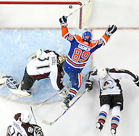 Edmonton Oilers center Sam Gagner (89) celebrates a goal (which was later given to teammate Robert Nilsson) and skates by Colorado Avalanche goalie Peter Budaj (31), from Slovakia, Brett Clark, right, and Daniel Tjarnqvist, from Sweden, in the first period of an NHL hockey game in Edmonton, Alberta on Saturday, Mar. 14, 2009.