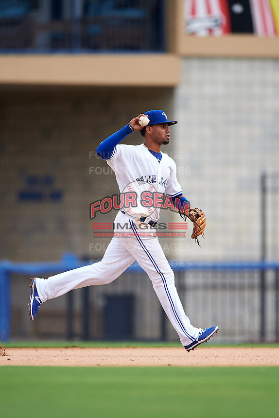 Dunedin Blue Jays second baseman Andy Fermin (23) throws to first during the first game of a doubleheader against the Palm Beach Cardinals on July 31, 2015 at Florida Auto Exchange Stadium in Dunedin, Florida.  Dunedin defeated Palm Beach 7-0.  (Mike Janes/Four Seam Images)