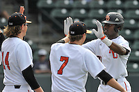 Center fielder Kyle Lewis (20) of the Mercer Bears is congratulated after a home run in a SoCon Tournament game against the Furman Paladins on Thursday, May 26, 2016, at Fluor Field at the West End in Greenville, South Carolina. Mercer won, 6-1. Lewis is considered a 2016 Top 5 draft pick. (Tom Priddy/Four Seam Images)
