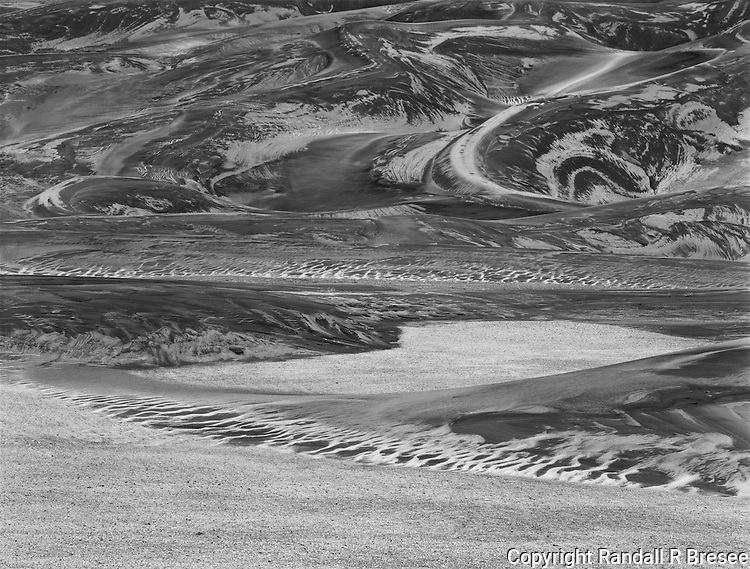 &quot;Serpents In The Sand&quot; The Great Sand Dunes National Park, Colorado <br /> <br /> The Great Sand Dunes offer visitors a myriad of visually complex scenes. Sand is sculpted by various forces into an endless number of fantastic shapes and textures. This black and white photo shows that the dunes stimulated the imagination of this photographer mightily.