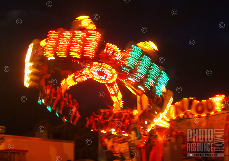 A 50th State Fair ride at night on O'ahu