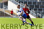 Castleisland Desmonds Pa White is tackled by Donal O'Connor Kenmare during their Intermediate semi final clash in Fitzgerald Stadium on Sunday