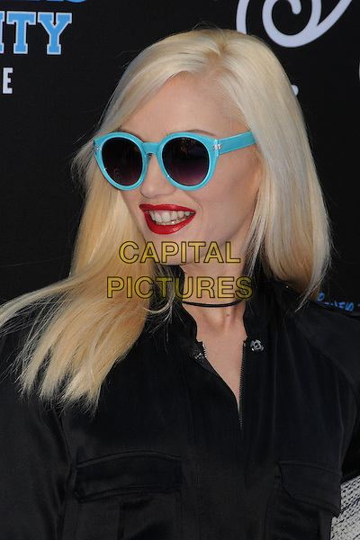 Gwen Stefani<br /> &quot;Monsters University&quot; Los Angeles Premiere held at the El Capitan Theatre, Hollywood, California, USA.<br /> June 17th, 2013<br /> headshot portrait blue turquoise sunglasses shades red lipstick black shirt <br /> CAP/ADM/BP<br /> &copy;Byron Purvis/AdMedia/Capital Pictures
