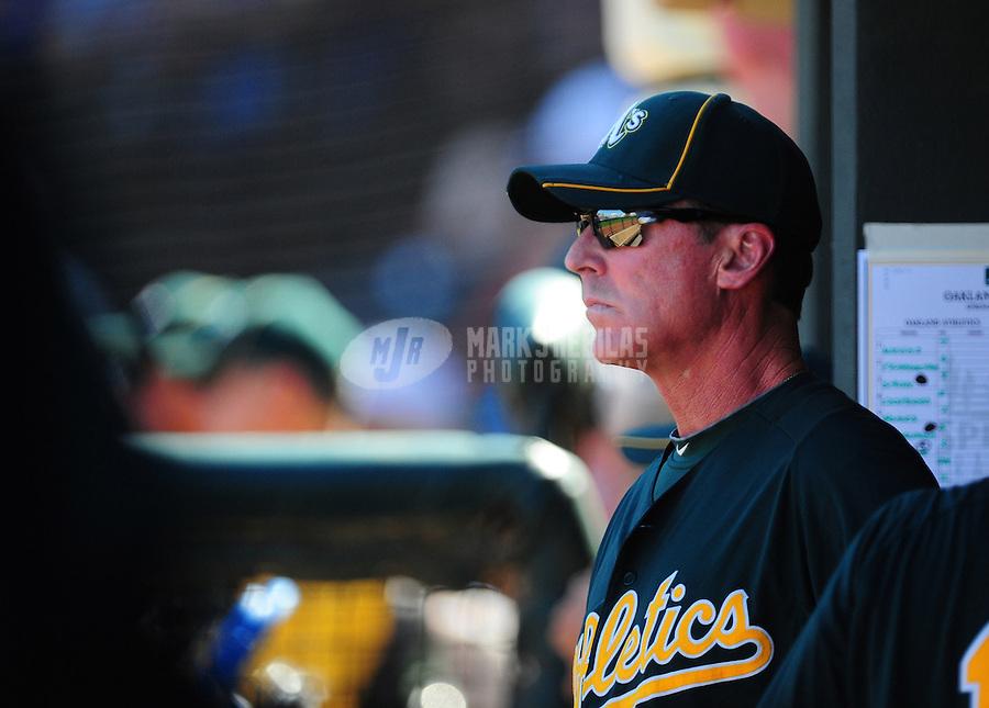Mar. 15, 2012; Surprise, AZ, USA; Oakland Athletics manager Bob Melvin in the third inning against the Texas Rangers at Surprise Stadium.  Mandatory Credit: Mark J. Rebilas-