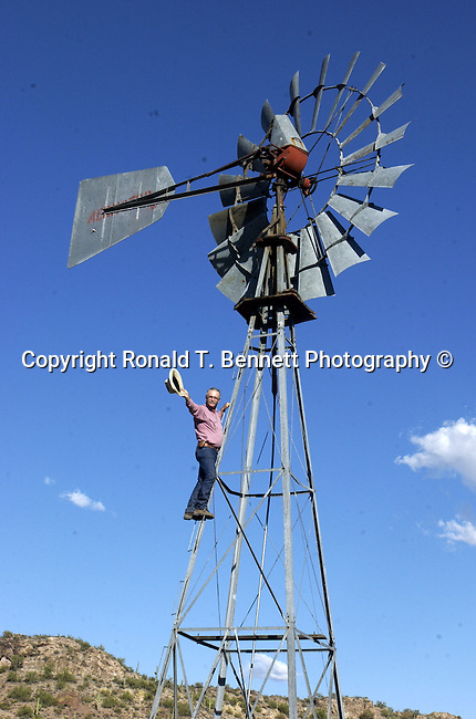 Carson Thomas, Carson Thomas on wind mill, Carson Thomas famous saddle builder Wickenburg Arizona, wind mill, Arizona, State of Arizona, Southwest, desert, 48th State, Last of contiguous states, Phoenix, Scottsdale, Grand Canyon, Indian reservations, four corners, desert landscape, exrophyte, western United States, Southwest, Mountains, plateaus, ponderosa pines, Colorado River,  Mountain lion, Navajo Nation, No daylight savings time, Arizona Territory, Arizona, AR, Fine Art Photography by Ron Bennett, Fine Art, Fine Art photography, Art Photography, Copyright RonBennettPhotography.com ©