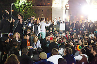 "Thousands of protesters with the ""Occupy Wall Street"" movement gather in Washington Square Park on October 15, 2011 in New York City.  After a largely frustrating (and occasionally dangerous) encounter with the police department after a march to Times Square the protesters try to collectively decide on whether or not to ""occupy"" Washington Square Park that night despite its curfew of midnight.  Shortly before the appointed hour it is agreed to meet on the subject the next night, although more than a dozen protesters do end up staying in the park regardless and are summarily arrested."