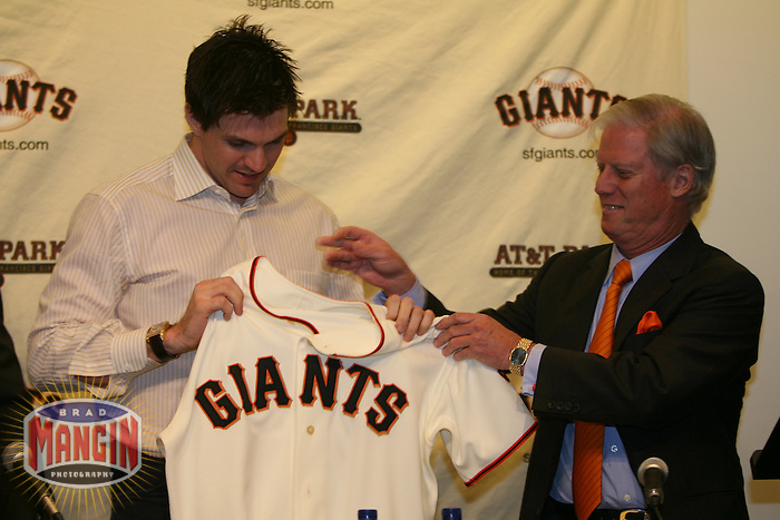 Barry Zito and Peter Magowan. Baseball: San Francisco Giants pitcher Barry Zito is introduced to the media at AT&T Park in San Francisco, CA on January 3, 2006. Photo by Brad Mangin