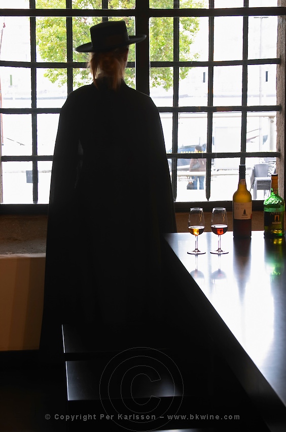 woman in black cape and hat sandeman port lodge vila nova de gaia porto portugal