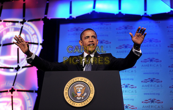 United States President Barack Obama speaks at the Building and Construction Trades Department Legislative Conference at the Washington Hilton Hotel, Washington DC., USA..April 30th, 2012 .half length black suit podium speech hands arms in air.CAP/ADM/CNP/OD.©Olivier Douliery/Pool/CNP/AdMedia/Capital Pictures.