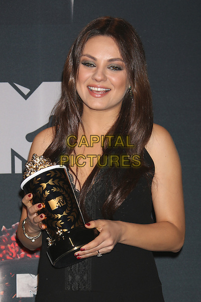 LOS ANGELES, CA - APRIL 13: Mila Kunis in the press room at the 2014 MTV Movie Awards at Nokia Theatre L.A. Live on April 13, 2014 in Los Angeles, California. <br /> CAP/MPI/JO<br /> &copy;Janice Ogata/MPI/Capital Pictures