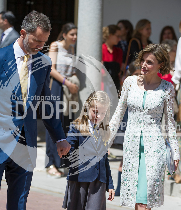 Queen Letizia; King Felipe VI; Princess of Asturias Leonor after First communion pose for media out of Church