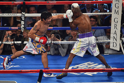 09.04.2016, Las Vegas, Nevada, USA. Manny Pacquiao (L) (Philippines) throws a punch during the Pacquiao versus Bradley Welterweight Championship fight in the MGM Grand Garden Arena at the MGM Grand Hotel and Casino in Las Vegas, Nevada. Manny Pacquiao (Philippines) defeated Timothy Bradley, Jr. (USA) by unanimous decision.