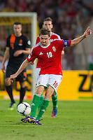 Hungary's Zoltan Gera kicks the ball during a World Cup 2014 qualifying soccer match Hungary playing against Netherlands in Budapest, Hungary on September 11, 2012. ATTILA VOLGYI