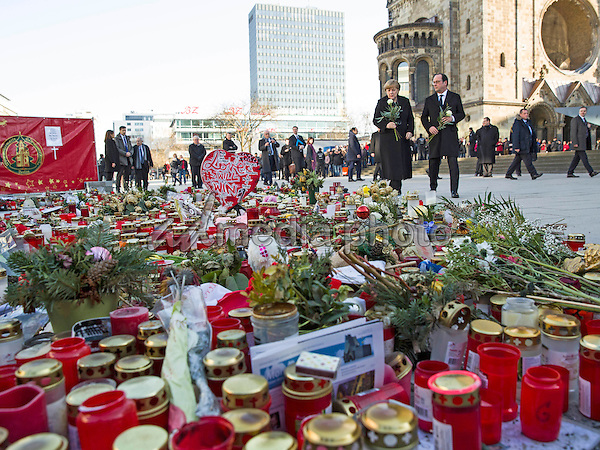 Federal Chancellor Angela Merkel and the French President Francois Hollande set flowers on January 27, 2017 in memory of the victims of the attacks at the Berlin Breitscheidplatz. Photo Credit: Stocki/face to face/AdMedia