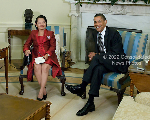Washington, D.C. - July 30 2009 -- United States President Barack Obama meets with President Gloria meets with President Gloria Macapagal-Arroyo of the Philippines of the Philippines in the Oval Office at the White House in Washington, D.C. on Thursday, July 30, 2009..Credit: Ron Sachs / CNP