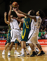 Tall Blacks forward Mika Vikona, Boomers forward Joe Ingles and Tall blacks forward BJ Anthony compete for a rebound during the International basketball match between the NZ Tall Blacks and Australian Boomers at TSB Bank Arena, Wellington, New Zealand on 25 August 2009. Photo: Dave Lintott / lintottphoto.co.nz