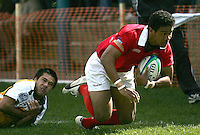 Tongan captain and fly-half Richard Kaufusi evades this attempted tackle to score one of his team's tries in the first half of the Div. B pool match of the Under 19 RWC at Malone, Belfast.