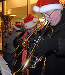 Members of a Brass Quintet play Christmas Carols on Main Street during the annual Christmas on the Green event in downtown Piqua on Friday.