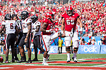 Nyheim Hines (7) of the North Carolina State Wolfpack celebrates after scoring a touchdown on a 2-yard run during first half action against the South Carolina Gamecocks in the Belk College Kickoff at Bank of America Stadium on September 2, 2017 in Charlotte, North Carolina.  The Gamecocks defeated the Wolfpack 35-28.  (Brian Westerholt/Four Seam Images)