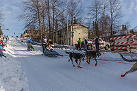 Anja Radano on Cordova St. hill during the Anchorage start day of Iditarod 2018 on Cordova St. hill during the Anchorage start day of Iditarod 2019