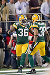 Green Bay Packers defensive back Nick Collins (36) celebrates an interception for a touchdown with teammate Tramon Williams (38)during Super Bowl XLV against the Pittsburgh Steelers on Sunday, February 6, 2011, in Arlington, Texas. The Packers won 31-25. (AP Photo/David Stluka)