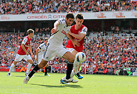 Pictured L-R: Danny Graham of Swansea is challenged by Laurent Koscielny of Arsenal. Saturday 10 September 2011<br />