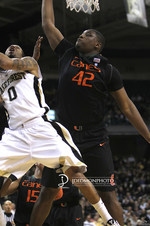 Wake Forest Demon Deacons guard J.T. Terrell (0) tries to get past Miami (Fl) Hurricanes center Reggie Johnson (42) at the basket. The score is tied at the half 37-37.