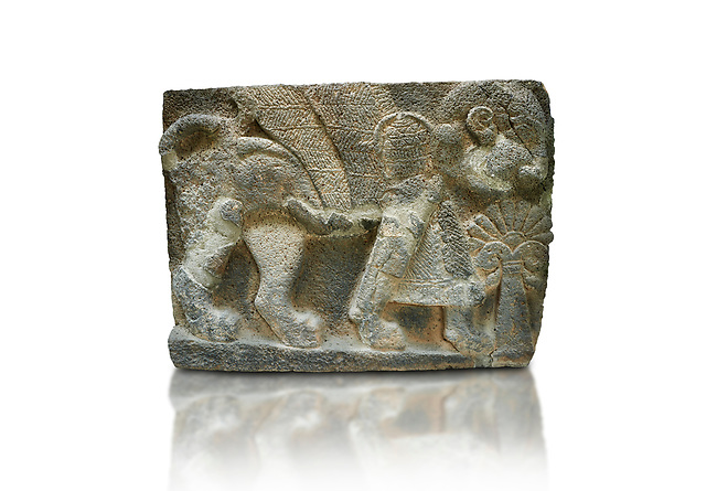 Pictures & images of the North Gate Hittite sculpture stele depicting Hittite winged God. 8th century BC. Karatepe Aslantas Open-Air Museum (Karatepe-Aslantaş Açık Hava Müzesi), Osmaniye Province, Turkey. Against white background