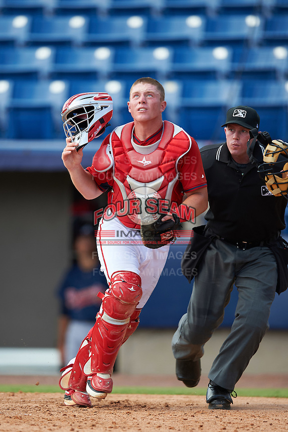Washington Nationals catcher Jakson Reetz (14) and an unidentified umpire look for a foul ball popup during an Instructional League game against the Atlanta Braves on September 30, 2016 at Space Coast Stadium in Melbourne, Florida.  (Mike Janes/Four Seam Images)