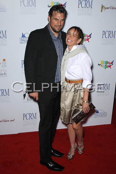 JASON ZIMMERMAN, MELISSA RIVERS. Red Carpet arrivals to The Art of Compassion PCRM 25th Anniversary Gala at The Lot in West Hollywood. West Hollywood, CA, USA. April 10, 2010.