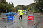 Flooding along Craiglockhart Avenue and at its junction with Colinton Road, Edinburgh.<br /> <br /> The Scottish Fire Service managed to reduce most of the flooding, which at one point earlier in the day had reached knee height at its junction with Craiglockhart Road.<br /> <br /> Several homes were sandbagged at their entrances with the street along Craiglockhart Road.<br /> <br /> However, another surge of water started to run down the Avenue, thought to be from Scottish Water's efforts to clear areas further up. <br /> <br /> Image by: Malcolm McCurrach