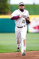 Aaron Conway (11) of the Missouri State Bears heads back to the dugout between innings during a game against the Oral Roberts Golden Eagles on March 27, 2011 at Hammons Field in Springfield, Missouri.  Photo By David Welker/Four Seam Images
