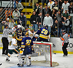 15 February 2008: The Merrimack College Warriors and the University of Vermont Catamounts scuffle behind the net at Gutterson Fieldhouse in Burlington, Vermont. The Catamounts defeated the Warriors 4-1 in the first game of their 2-game weekend series...Mandatory Photo Credit: Ed Wolfstein Photo
