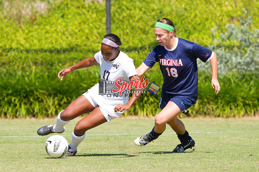 India Winford #17 of the Wake Forest Demon Deacons controls the ball in front of Amanda Fancher #18 of the Virginia Cavaliers at Spry Soccer Stadium on October 2, 2011 in Winston-Salem, North Carolina.  The Demon Deacons defeated the Cavaliers 2-0.  (Brian Westerholt / Sports On Film)