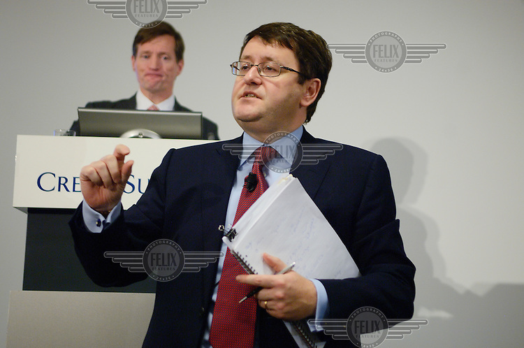Chief Financial Officer David Mathers responds to a journalist's question at a press conference to announce the annual results of Credit Suisse. His boss, CEO Brady Dougan, stands behind at the podium. The Swiss banking industry holds an estimated 4,000 billion Swiss Francs (USD 4,240 billion) in assets, more than half of it foreign, including CHF 880 billion in undeclared European assets alone, benefiting from the country's famous banking secrecy laws.