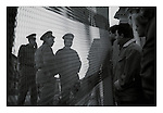Young East German border guards talk with West Berliners at the fence where the Berlin Wall met the River Spree behind the Reichstag in Berlin, a few days after the collapse of the DDR in November 1989. Photograph copyright Graham Harrison.